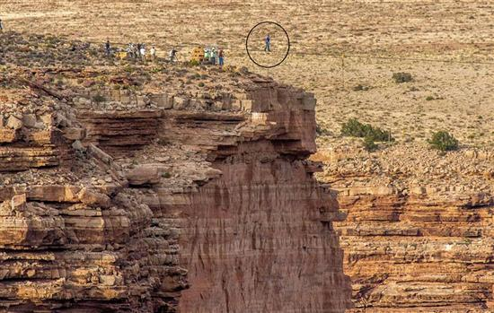 man crossing grand canyon on rope 2
