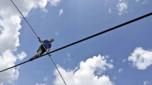 man crossing grand canyon on rope 3