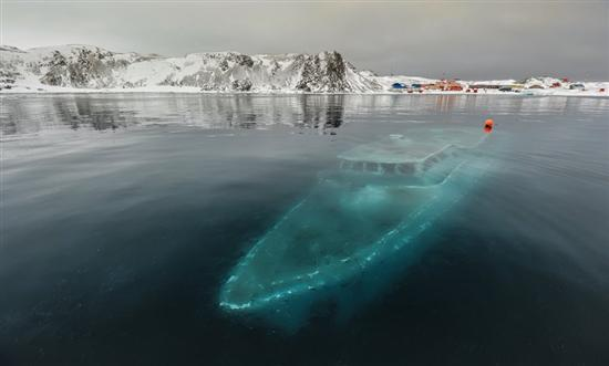 Sunken yacht Antarctica 10 of the Coolest Abandoned Places In The World as seen on CoolWeirdo.com