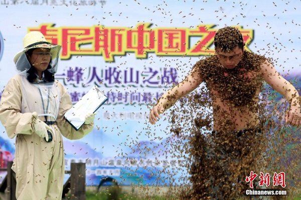 man covered bees for hour