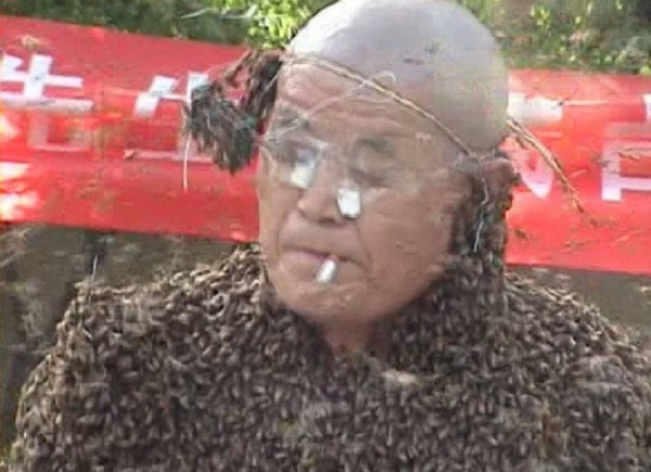 man covered by most bees