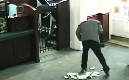 bank robber drops money