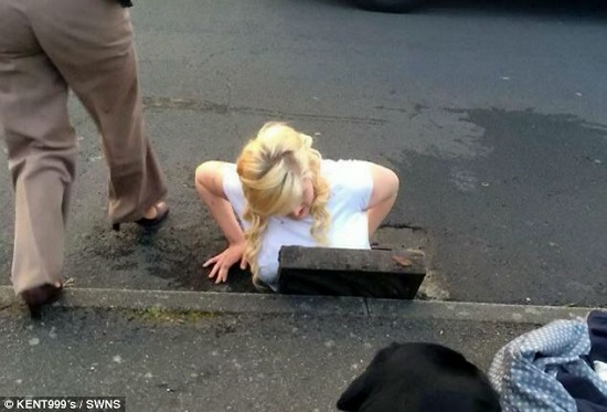 girl stuck sewer