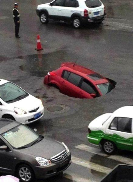 China pothole family car falling 438x600