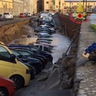 cars falling into gigantic hole