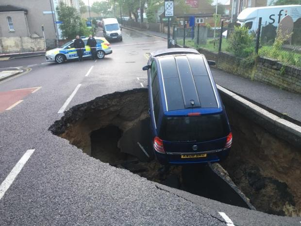 cars falling into sinkhole around world uk