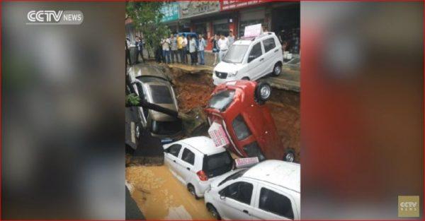 giant sinkhole cars china 600x313