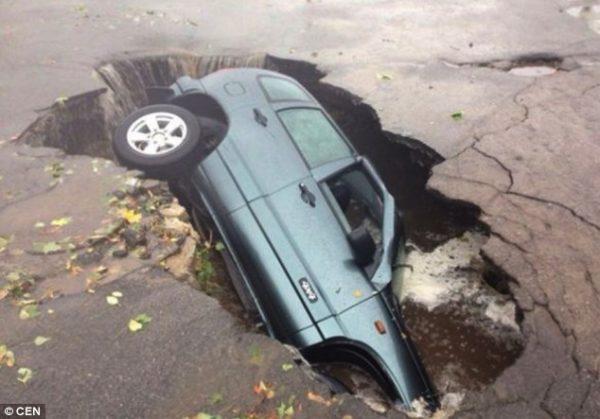 southeastern ukraine pothole car fell  600x419