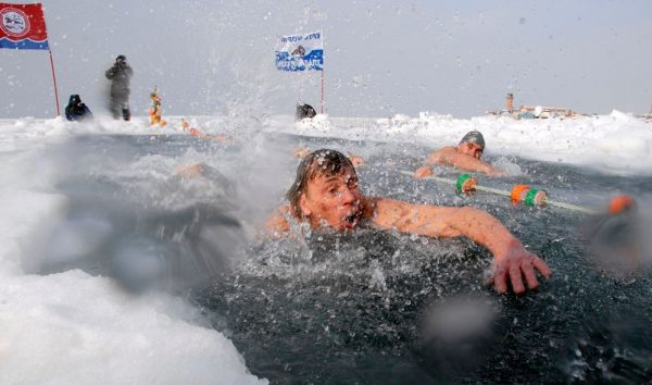Freezing Winter Ice Swimming Bath In Russia  600x354