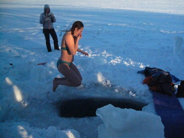 minnesota girl jumping in frozen lake 600x450