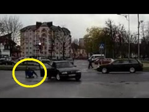 man falling from moving car in russi